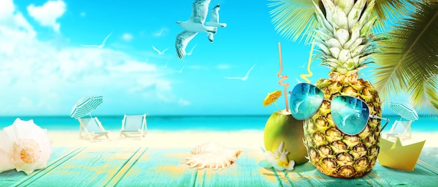 Creative pineapple with sunglasses on summer background.
