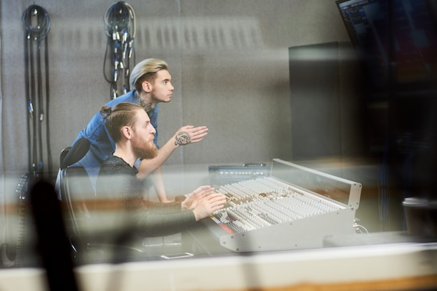 Creative producers making music in studio