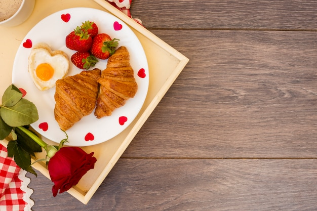 Creative romantic breakfast on tray