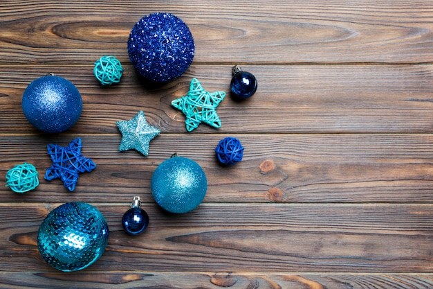 Creative set of new year baubles and decorations on wooden background. top view of christmas time concept. copy space