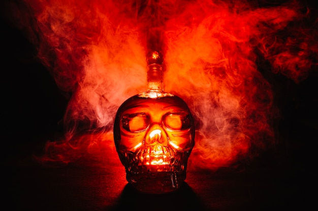Creative skull-shaped bottle in smoke