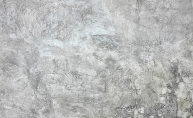 Творческий рисунок штукатурки, нейтральные серые цвета, старый фон стены из цемента.