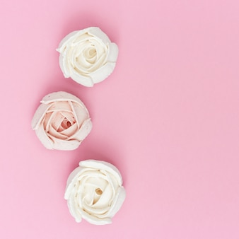 Creative sweet food, flat lay with pink and white marshmallows in form flower. holiday concept.