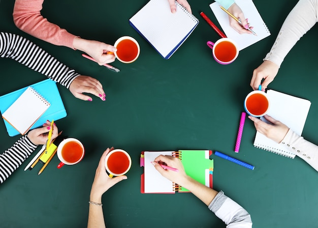 Creative team for work flow on blackboard top view