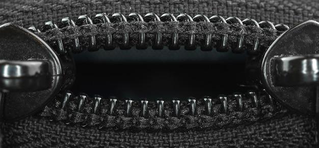 가방 지퍼 클로즈업, 복사 공간 사진이 있는 크리에이 티브 섬유 배경 배너