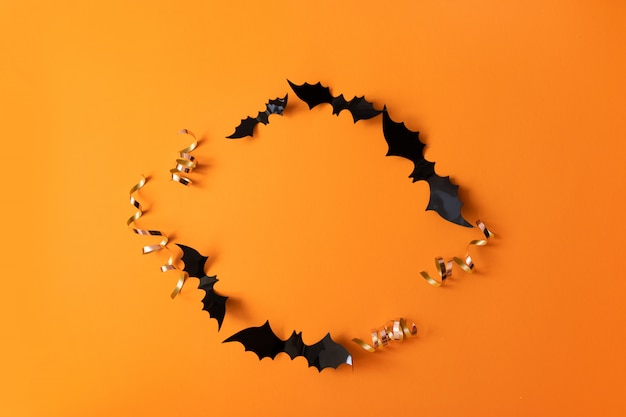 Creative top view flat lay autumn halloween composition of black paper bats frame