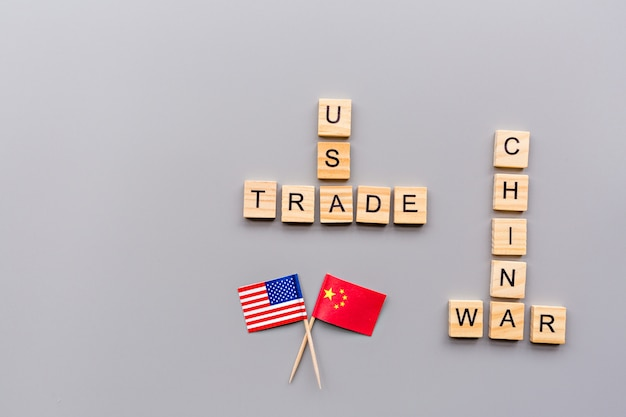Creative top view flat lay of usa and china flags