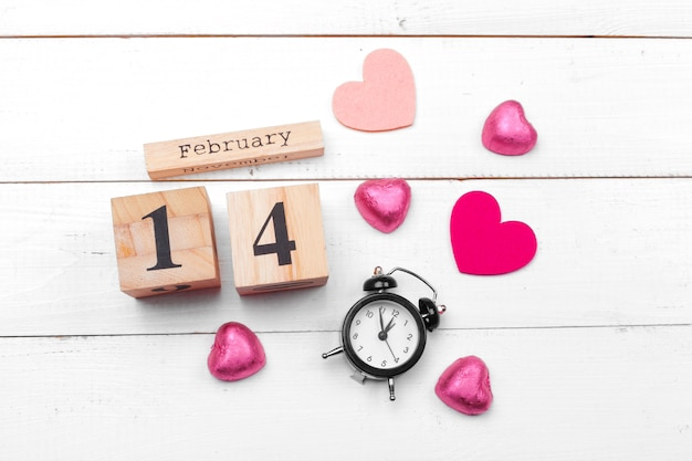 Creative valentine day romantic composition flat lay top view love holiday celebration red heart calendar date