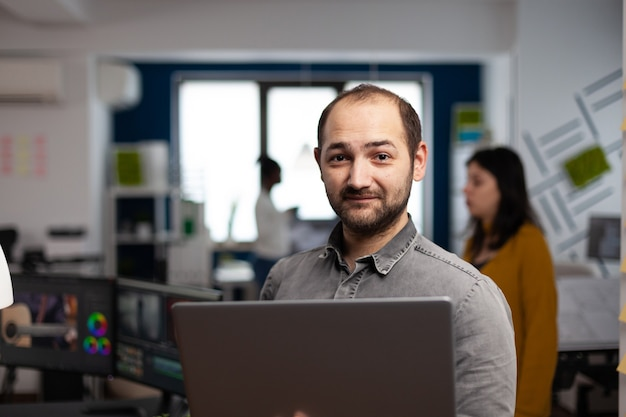 Creative video editor worker standing in front of camera