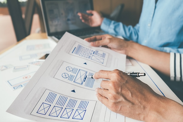 Creative web designer planning application and developing template layout