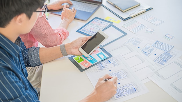 Creative web designer planning application, framework for mobile phone. user experience (ux) concept.