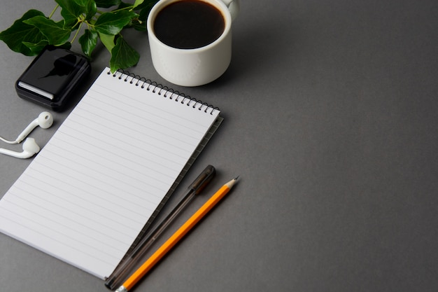 Creative work space, desk. notebook and coffee cup. mockup.