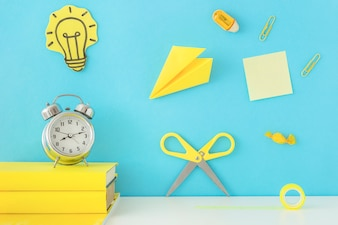 Creative workplace for inspiration with yellow writing accessories