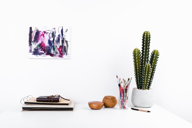 Creative workplace with plant