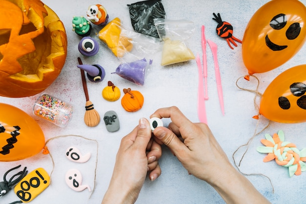 Creative workplace with plasticine and halloween figures