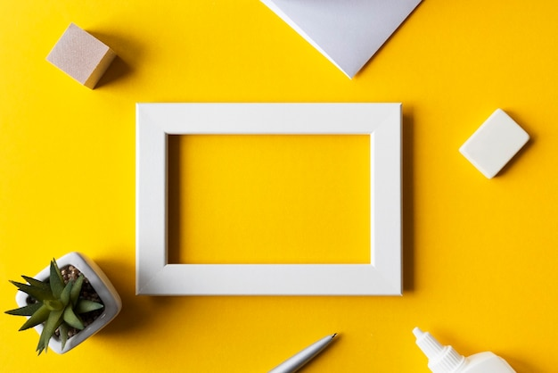 Creative workplace or workspace with bright yellow surface