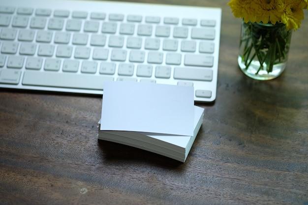 Creative workspace white name card on desk with keyboard