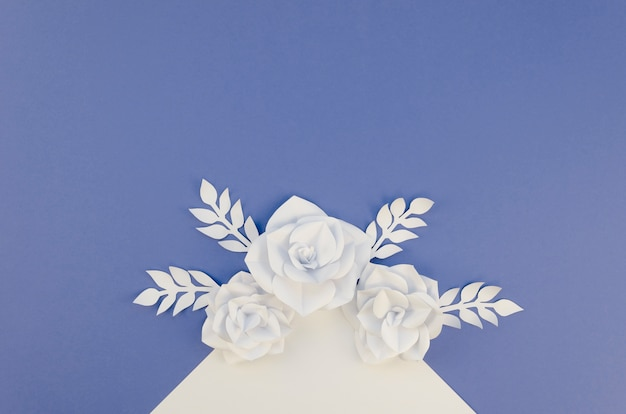 Creativity concept with white paper flowers