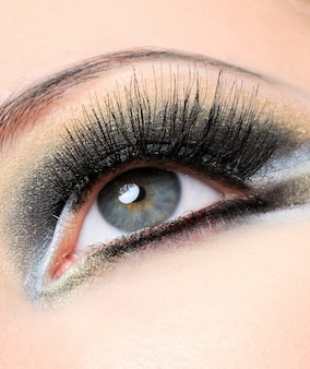 Creativity golden-brown modern make-up with long eyelashes