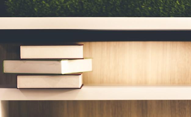 Creativity stacked old books on wooden bookshelf