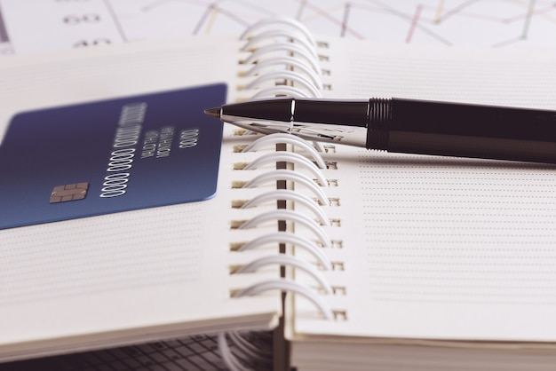 Credit card and ball pen on a organizer