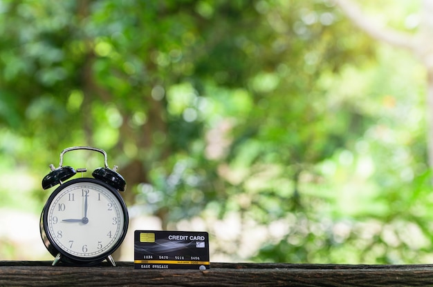 Credit card on desk wooden floor background bokeh blur from sunlight