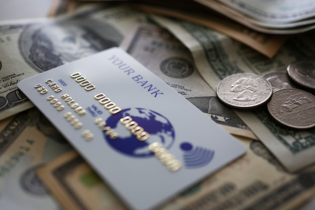 Credit card lying at big amount of us currency