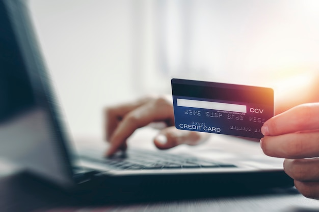 Credit card making online payment and internet shopping by laptop.