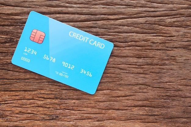Credit card on old brown wood