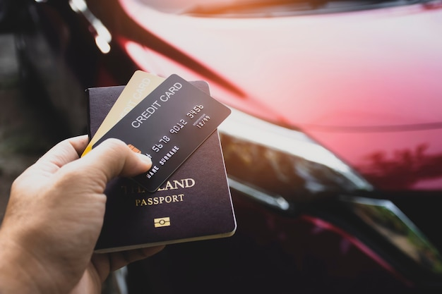 Credit card and  passport for international car rental in the tourist hand