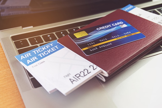 Credit card and passports on laptop