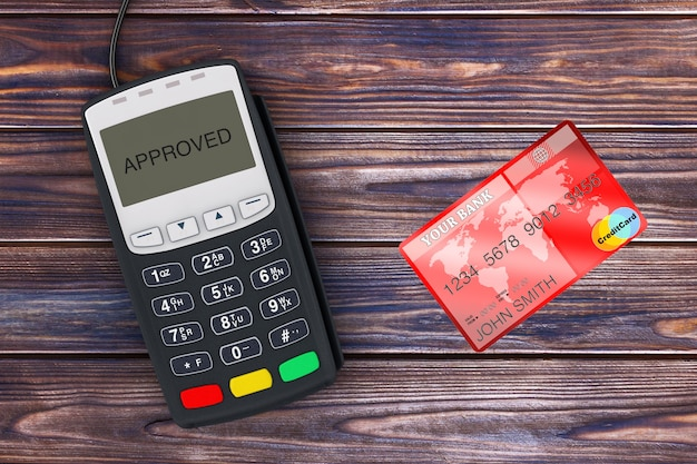 Credit card payment terminal with red credit card on a wooden plank table. 3d rendering