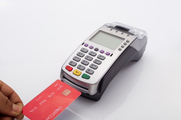 Credit card and pos terminal on white