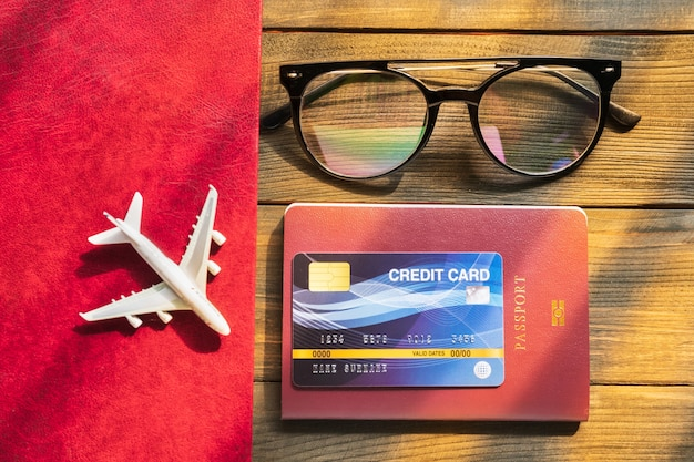 Credit card put on passport on wooden desk  preparation for traveling concept
