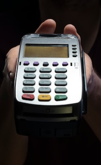 Credit card reader isolated on black background