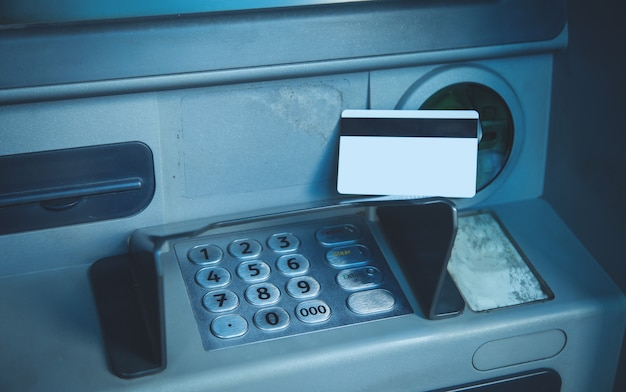 Credit card sitting on an atm machine