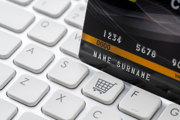 Credit card with icon on keyboard for online shopping