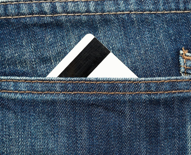 Credit card with magnetic stripe in the back pocket of jeans