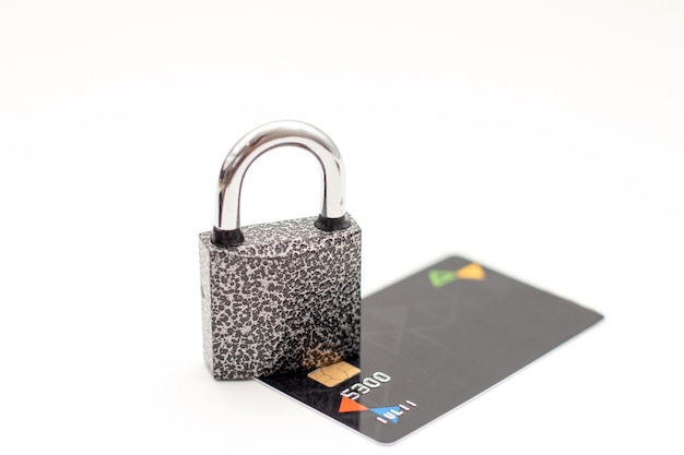 Credit card with padlock safe data and protected paying concept