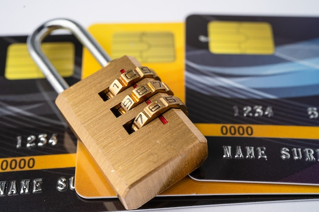 Credit card with password key lock isolated on white background.