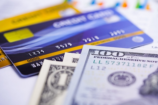 Credit card with us dollar banknotes.
