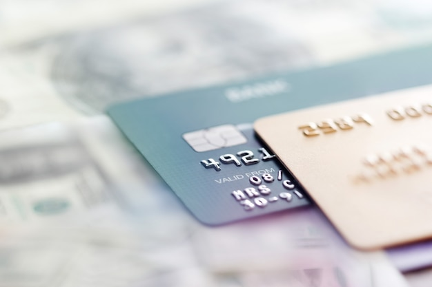 Credit cards on a banknotes background