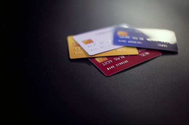 Credit cards on black surface
