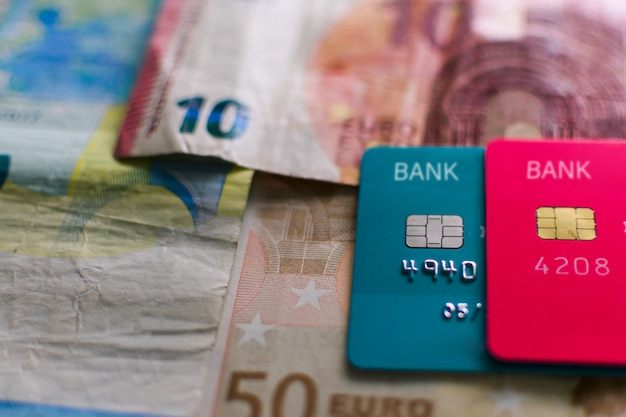 Credit cards on money, defocused.