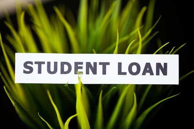 Credit . student loan written on white card