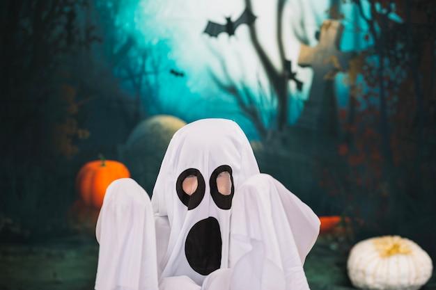 Creepy ghost at graveyard