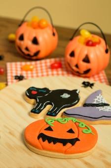 Creepy halloween cookies next to a milk glass