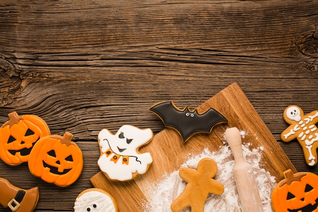 Creepy halloween cookies on a wooden background