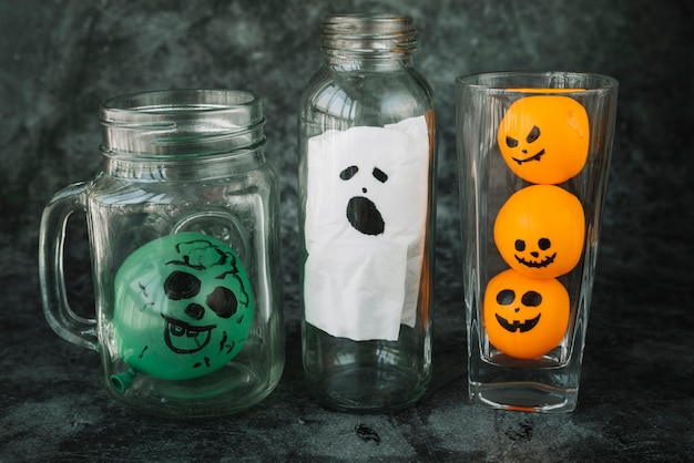 Creepy halloween pictured faces in glassware