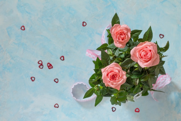 Creeting valentines day, mothers day or birthday. bouquet of fresh rose flowers. top view.